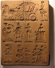 An antique springerle mold showing wedding images.