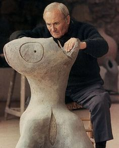 Joan Miró working on his ceramic sculpture 'Femme Verte' - (1968)