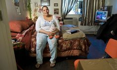 Lissette Encarnacion in her apartment at The Brook, a supportive housing complex in the Bronx