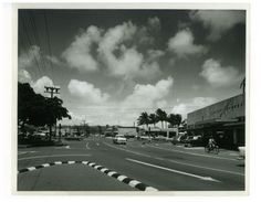 "Kailua, 1957.""Not one, not two, but three locations in the Hawaiian Islands bear the name Kailua, which means, ""two seas,"" and probably refers to ocean currents. In addition to Maui and Hawaii, here's Kailua, Oahu's main intersection, in 1957. (Irving Rosen, Bishop Museum Archives)"" — Bishop Museum."