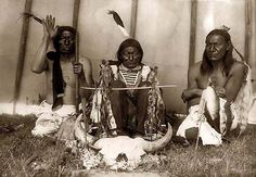 Indian Altar, A Bison skull. Left to right; Slow Bull, Saliva, and Picket Pin~ Prayer ceremony.