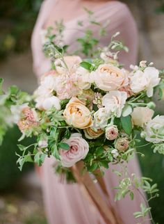 lush pastel peach bouquet - photo by Greg Finck Photography http://ruffledblog.com/modern-romantic-wedding-in-provence