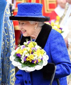 Her Majesty Queen Elizabeth II hands out Maundy Thursday coins to the public after services at St. George's Chapel, Windsor. March 29, 2018