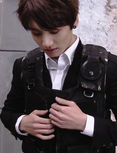 Jungkook rip off bulletproof vest gif
