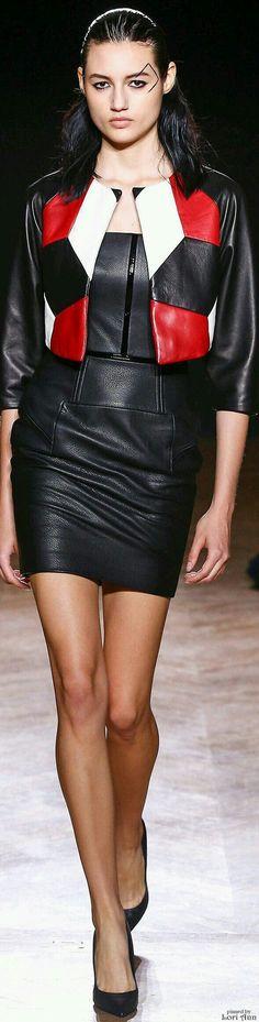 Black leather dress and cropped leather jacket ensemble runway fashion