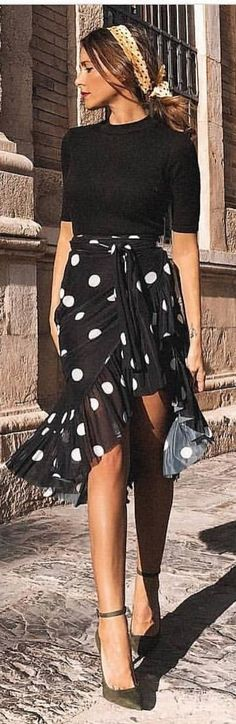 #spring #outfits woman wearing black and white 3/4-sleeved shirt and black polka-dotted skirt standing beside brown concrete wall. Pic by @fashionstyles2me