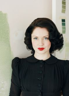 I love everything about this picture! Cute hair, red lips and black dress.. Love it!