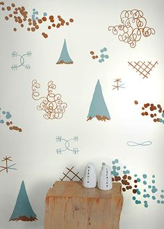"Juju ""Family Reunion"" wallpaper in aquatic and gold."