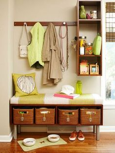 You don't need a lot of space to create a simple mudroom. This small but efficient setup features hooks, baskets, and shelves that keep clutter organized and out of sight. A cushy bench serves as a perch for taking off shoes. You can re-create this simple mudroom in your own home. For the bench, buy a single stock-cabinetry unit; prime, paint, or stain the cabinetry; remove the doors for open storage; and attach legs to the base of the cabinet to make the bench a more convenient height. Do…
