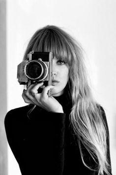 Woman, female, behind camera, hand, fingers, focus, concentration, portrait, photograph, photo b/w.