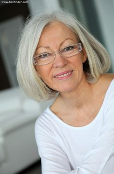 blunt cut almost shoulder length hairstyle for an older woman with gray hair