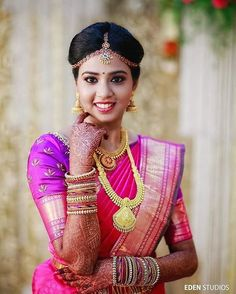 Bold Red and Purple Silk Saree on a South Indian Bride with Gold Jewelry