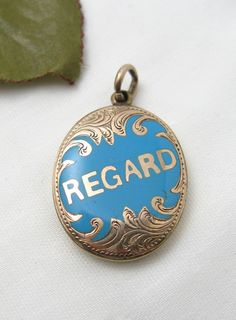 "Victorian 9K & Enamel 'Regard' Locket    Charming petite 9 carat gold and turquoise blue enamel ""Regard"" locket from England. The locket displays a photo on the back side. It measures 1-1/8"" by 9/16,"", not including the bale."