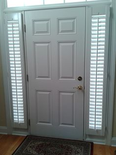 """Front door sidelights are an attractive solution for privacy and light control. These plantation shutters have 2.5"""" louvers that offer a more traditional style."""