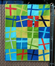 Sunshiney Day Wonky Cross Quilt with a good description of how it was made and quilted with a walking foot | A Quilter's Table