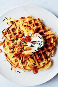 This quick and easy 40-minute loaded potato waffle recipe incorporates potatoes, eggs, cheddar cheese, bacon, chives and sour cream to create the ultimate comfort food meets breakfast recipe. Whether you're looking to eat this potato recipe as is or alongside eggs, bacon or sausage, it's a great choice for a brunch recipe.#breakfastrecipes #brunchrecipes #weekdaybreakfasts #wafflerecipes #potatorecipes #comfortfood