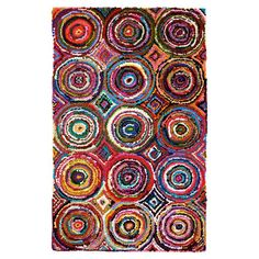 Lend a bright, boho-chic touch to your living room or master suite with this eye-catching rug, crafted from upcycled cotton in a concentric circle motif.