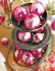Decorating With Vintage Christmas Ornaments   BY DENISE:   Sometimes the simplest Christmas decorating is the most beautiful. I loved finding these easy decorating ideas using Christmas glass ornaments, and wanted to pass them onto you. I really like the vintage feel to all these holiday displays below. Think about pulling out your own antique silver platters, old mercury glass, or any vintage inspired vessels that could hold Christmas ornaments. Also think about using different color…