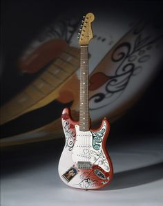 DREAM / WANT IT. Jimi Hendrix's Monterey Pop Strat replica.... I have the art from this guitar tattooed covering my left forearm. Beautiful Guitar.