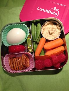 Vegetarian bento lunch - boiled egg, cheese, hummus, pretzels, fresh fruit and veggies #lunchbots
