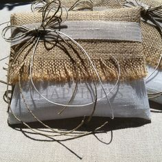 Wedding favors in the form of burlap and fabric envelopes filled with love and wishes for the newly married couple. Guests could also write their tidings, hopes and wishes to the couple in the matching Welcome Wish book.  #myhappiness.gr #wedding #weddingfavors #bombonieres #bomboniere #wishbook.  For more information: www.myhappiness.gr