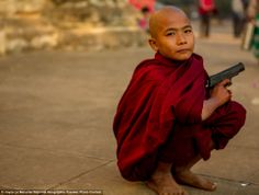 Photo and caption by Joyce Le Mesurier. It was only a toy gun! Location: Bagan, Myanmar