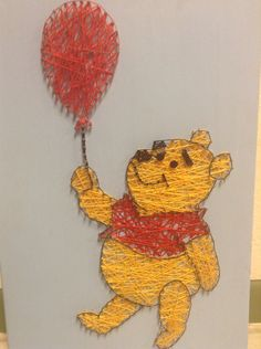 cute winnie the pooh nail and string art picture on wooden board.