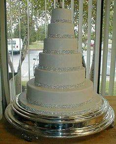 Bedazzled blinged out multi-tier wedding cake. Beautiful!