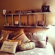 I absolutely love the idea of the ladder as a headboard. It offers plenty of space to put up knick knacks, pictures, and anything else you want to put on display in your bedroom. This particular design features a small rustic ladder, but depending on how creative you want to get, you can use some that are larger or more of a new style. Not to mention, it's super easy to hang and maintain!