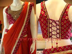 Sienna Orange georgette banarsi silk border in purple pink. Banarsi corset style blouse with heavy embellishments on yoke.