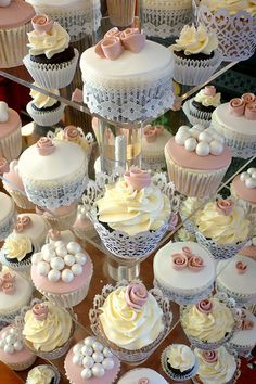 This is a lovely set up of 50 cupcakes with a gorgeous vintage theme. The colour palette on this order was made to match the brides dress and this stand was topped with a cake topper instead of the traditional cutting cake that a lot of couples opt for nowadays.  This style is inspired by Tracy @ Cotton and Crumbs work and is replicated with her kind permission!