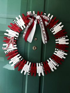 Handmade Alabama Crimson Tide wreath is made with care and love. Clothes pins make up the majority of the wreath. Each clothes pin is hand painted on all surfaces with special order Glidden brand team colors (for the perfect team color match) then sprayed with polyurethane to lengthen the lifespan of the wreath. Another coat of polyurethane is applied. It is finished off with a bow. Roll tide!!Perfect for football season or to hang year round to show pride and support for your favorite team…