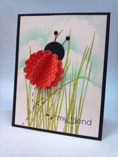 """Cute for a girls' birthday card! Sponge clouds using large scallop punch. Stamp Grass. Small scallop punches + 1"""" circle punch + 2 lines + 2 brads = lady bug."""