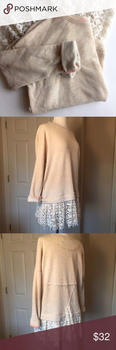 Free People Lace-Hemmed Pullover Cozy and cute pullover by FP Beach. Sweatshirt material with a lacy ruffle accent at the hem. Looks great with leggings! The tag says XS/S but is meant to be oversized so a larger size could probably wear (pictured on a size small mannequin). Free People Tops Sweatshirts & Hoodies