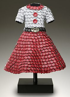 """John Petrey is an artist from Chattanooga, Tennessee who makes sculptural dresses from a variety of cast off materials, including old barn board, asphalt shingles, and even used bottle caps (below). Here is what Petrey says about his amazingly creative """"Dress Series"""" collection."""