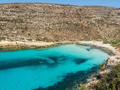 The picturesque Cala Pulcino is located on Lampedusa, the largest of the Italian Pelagie Islands. You'll need to hike over rocks and through thick vegetation to get there—for about half an hour—but upon arrival, you're rewarded with powdery white sand, spectacular views, and the endless blue Mediterranean in front of you.