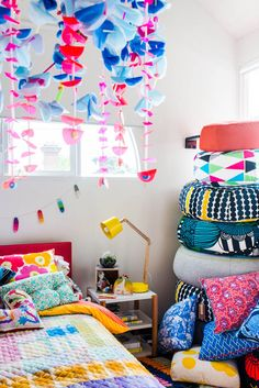 amazing Kids space featuring ottomans by Jardan (printed fabrics are Marimekko), Nook single bed by Jardan, lamp by Workroom, hanging mobile by Emily Green.   Photo - Brooke Holm