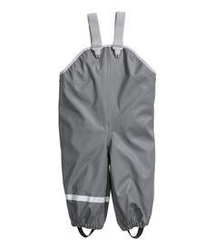 Dark gray. Rain pants in waterproof fabric with fluorocarbon-free, water-repellent coating and welded seams. Adjustable elasticized suspenders, snap
