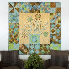 """The Flower Pot Sampler Quilt pattern features a combination of beautiful patchwork and appliqué.  This whimiscal quilt uses the GO! Qube Mix & Match 12"""" Block and GO! Simple Shapes by Edyta Sitar dies, for quick and easy piecing and appliqué.  You'll get complete directions in the pattern for a 60 1/2"""" x 60 1/2"""" quilt.Compatible with these fabric cutters:GO!GO! Big      Studio**Must use with GO! Die AdapterLearn How to download quilt patterns.Fabrics are from the Color Daze Pri..."""