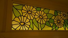 Daisy-inspired fanlight window made of leaded stained glass