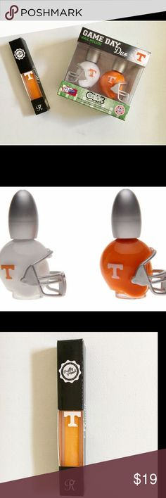 TENNESSEE VOLUNTEERS NAIL POLISH & GLITTER GLOSS Be the envy on game day with this trio of Ceci nail polish and glitter lipgloss.  The exclusive officially licensed orange and white nail polish sits proudly in it's helmet.  Go ahead and pucker up with this glittering lipgloss & cheer on another Tennessee win!  New with tags!  Smoke free home. Happy shopping🎉 Makeup