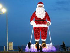 Slideshow : Giant illuminated Santa Claus model - How the world is gearing up for Christmas celebration - The Economic Times