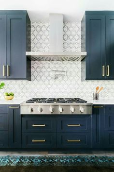 Love the blue cabinets and backspash behind the stove.  We would do white cabinets above and blue below.