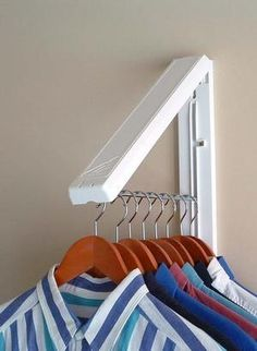 "Collapsible wall mounted clothes storage system creates 12"" of hanging space & holds up to 50 lbs! Weather resistant for out door use. $14.95"