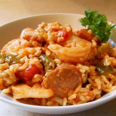 Find Mardi Gras King Cake and recipes for classic Cajun and Creole favorites like gumbo, jambalaya, hurricanes, and more! Slow Cooker Jambalaya, Jambalaya Recipe, Vegetarian Jambalaya, Shrimp Jambalaya, Sausage Jambalaya, Cajun Recipes, Seafood Recipes, Cooking Recipes, Cajun Cooking