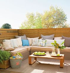 Love this outdoor lounge area, lots of pillows are totally necessary.