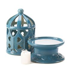 Get the glow of a candle without any worry! This gorgeously glazed blue ceramic lantern comes with an LED candle that flickers like the flam...