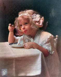 Girl eating ice cream. Colorized by Steve Smith from an original back and white photo. #victorians #children #icecream #hairbows #childhood