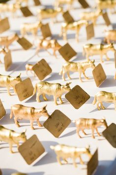 gold animal escort cards
