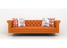 Frank's dulcet tones are ever present in this beautiful sofa. Bring the classic crooner to your living room for unmatched style and comfort. Finished in Hermes Orange Faux Leather with polished brass